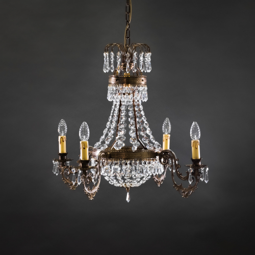 The classic Empire 4 crystal chandelier with candle placements brings a timelessly and elegant atmosphere to even the larger spaces.
