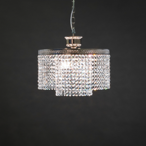 A chandelier full of crystal sparkle. Round PL is a modern crystal lamp that brings spectacular brilliance to its surroundings.