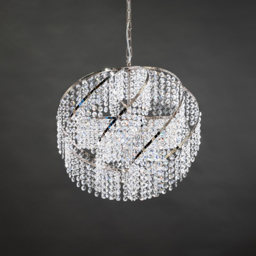 A Chandelier Pallo 1050 made from genuine crystals. This crystal lamp attracts attention and illuminates the room.