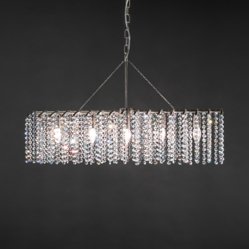 The modern crystal lamp Rake 8 is a longitudinally styled crystal chandelier with sparkling crystals, which is suitable for a dining room, for example.